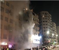 أول صور من موقع حريق شقة سكنية في الدقي