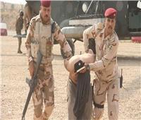 اعتقال 12 داعشيا في عملية أمنية جنوب الموصل بالعراق