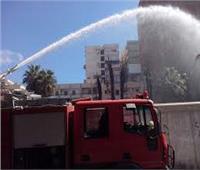 السيطرة على حريق محل تجاري بالدقي بدون إصابات