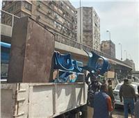 ضبط سيارات تلقي المخلفات بالشارع  في الجيزة