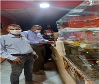 متابعة الإجراءات الاحترازية على المحلات التجارية بأسوان