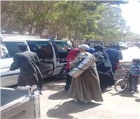 حملة مكبرة لتطهير وتعقيم سيارات الميكروباص بمركز «ملوي»