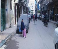 حكايات| سامية «أم البنات».. أشهر سايس سيارات بدمنهور
