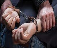 ضبط شخص بتهمة إلقاء الأموال على المواطنين من شرفة منزله بالجيزة