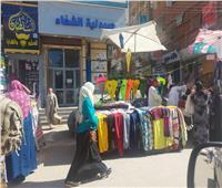 اقبال كبير على شراء ملابس العيد وارتفاع الأسعار يحرق جيوب المنياوية