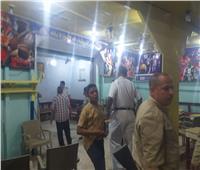 غلق مقهى مخالف لمواعيد الحظر في منشأة القناطر بـ«الجيزة»| صور
