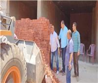 ضبط أعمال بناء مخالف داخل محل في الطالبية بالجيزة