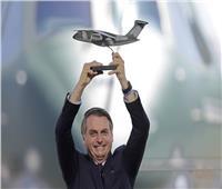 الرئيس البرازيلي من الطائرة لمنتقديه: سافروا على الحمير