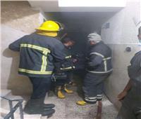 السيطرة على حريق شقة سكنية في أسيوط| صور