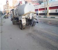 رش الشوارع وحملات نظافة لإزالة المخلفات في المنيا