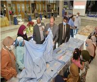 توزيع 10 أفران منزلية وماكينات خياطة لذوي الهمم في أسيوط