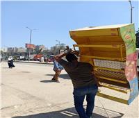 الجيزة: إلغاء سوق عشوائي وغلق وتشميع ٦ محال تجارية| صور