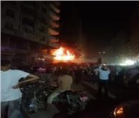 امتداد نيران حريق محل سجاد بفيصل لأحد العقارات المجاورة