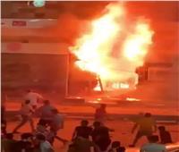 الدفع بخزان مياة للسيطرة على حريق محل للسجاد أسفل عقار بالطالبية