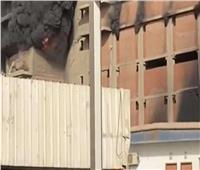 المعمل الجنائي بالمنيا يعاين موقع حريق حريق أسفل مبني غير مأهول بالسكان في المنيا