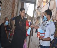 الكشافة الكنسية توزع كمامات على المحتفلين بعيد العذراء مريم بإسنا
