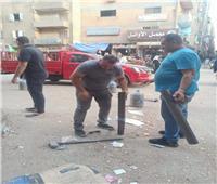 استجابة للمواطنين.. إزالة أوتاد حديدية وتعديات بشارع في العمرانية| صور