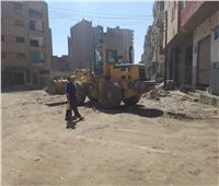 استمرار رصف الطرق بمدينة المعلمين في أسيوط