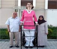 فتاة تدخل على موسوعة جينيس كأطول امرأة في العالم