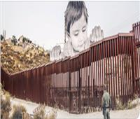 «جيه آر» يكشف تجاعيد وجوه المدن عن طريق الرسم على الجدران