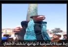 بالفيديو.. مواطنون يعلقون سيدة بعمود إنارة لمحاولتها خطف طفل