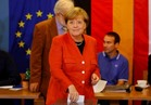 فيديو  ميركل تدلي بصوتها في الانتخابات الألمانية