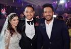 صور| حماقي يشعل زفاف «محمد ومي».. والعروس تتألق بفستان «البحيري»