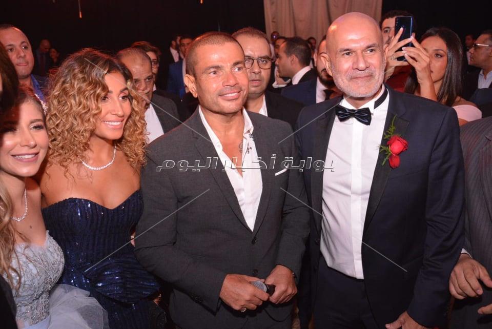 دينا الشربيني بصحبة عمرو دياب لحفل زفاف نجل هاني شاكر